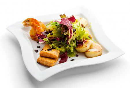 Photo for Seafoods - Shrimps, Sea Scallops, Squids and Salmon. Garnished with Fresh Raw Salad Leaf. - Royalty Free Image