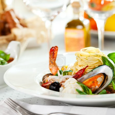 Photo for Seafood Spaghetti with Tiger Prawns, Scallops, Mussels, Calamari, Salmon and Tomato Sauce - Royalty Free Image