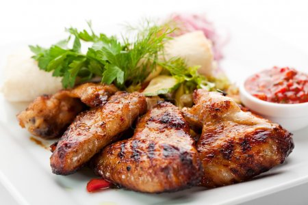 Photo for Hot Meat Dishes - Grilled Chicken Wings with Red Spicy Sauce - Royalty Free Image