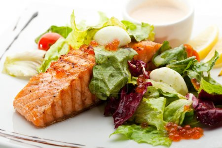 Grilled Salmon with Vegetables, Eggs and Sour Crea...