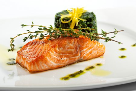 Photo for Baked Salmon Steak with Spinach and Lemon Slice - Royalty Free Image