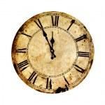 Five minutes to twelve on isolated vintage clock....