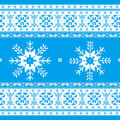 Traditional christmas knitted ornamental pattern with snowflakes blue and white