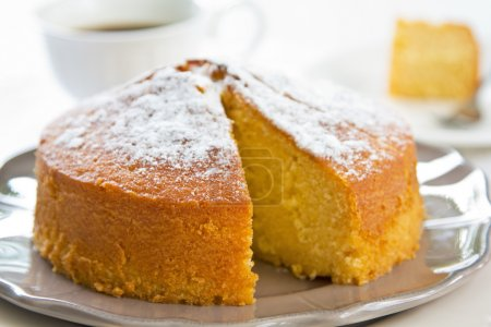 Butter cake with orange zest and juice by coffee...