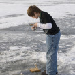 Boy Ice fishing on a frozen Minnesota Lake...