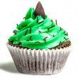 Greencreamed sweet cupcake on white background...