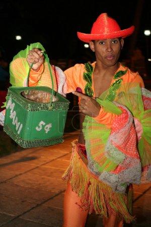 Cuban dancer collect money after show