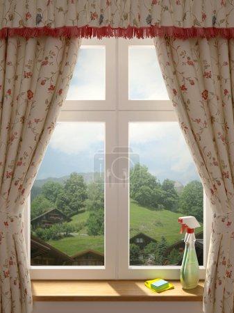 Photo pour Juste lavé fenêtre avec une vue magnifique sur le village et la décoration dans des rideaux de style campagnard - image libre de droit