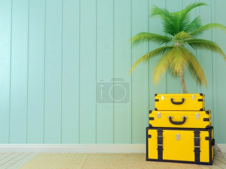 Photo for Bright yellow bags on the background of blue wall and a beautiful palm tree - Royalty Free Image