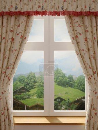 Photo pour Fenêtre avec une vue magnifique sur le village et décoration dans des rideaux de style campagnard - image libre de droit