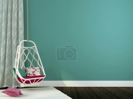 Photo for Convenient hanging chair with pink pillows on a background of blue walls and white curtains of guipure - Royalty Free Image