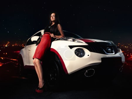 Photo for Charming girl on high heels standing near car - Royalty Free Image