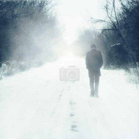 Photo for Man walks alone - Royalty Free Image