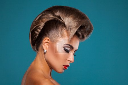 Charming woman with unusuall hairstyle looking down