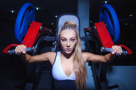 Workout of athletic woman at gym