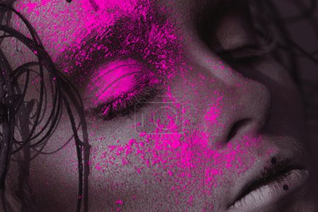Portrait of sexy adult girl with neon powder on face