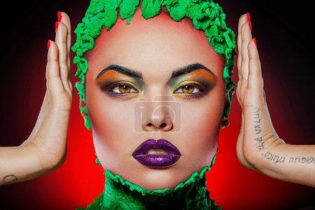 Girl looking at camera with creative makeup