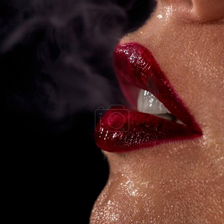Photo for Macro photo of wet woman's lips with smoke on black background - Royalty Free Image