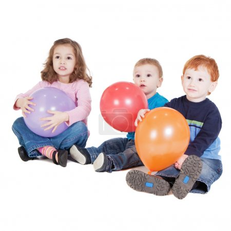 Three kids with balloons at party