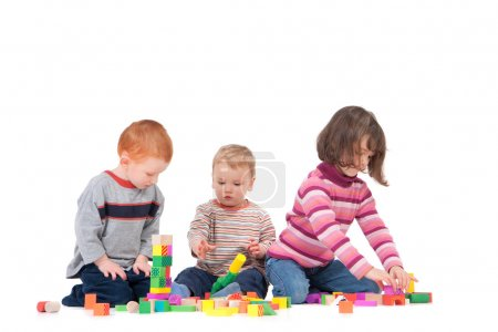 Preschoolers playing with wooden blocks