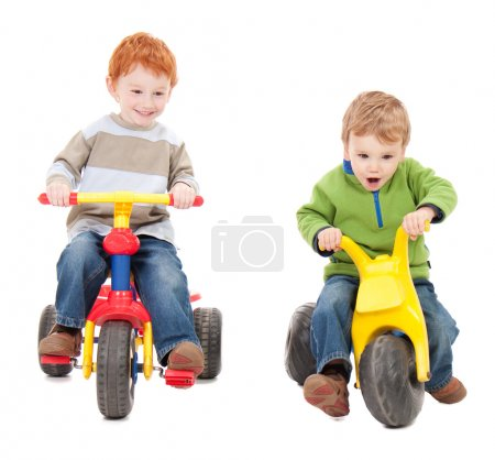 Children riding kids tricycles