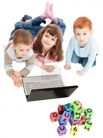Children learning with kids alphabet blocks and computer