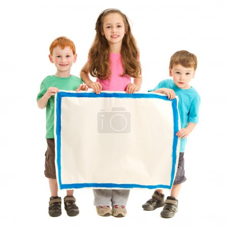 Happy kids holding blank sign