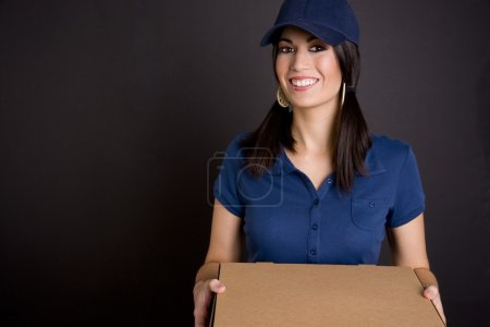 Photo for Pizza delivery girl in blue - Royalty Free Image