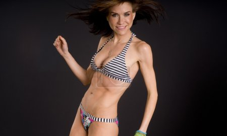 Fun Loving Woman Wearing Swimsuit Bikini Moves Smiling Dancing