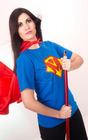 Everyday Housewife Mom Sweeps Broom Resembling Super Hero