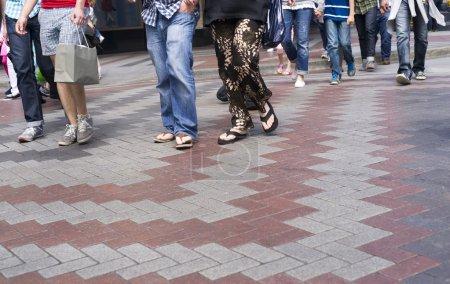 Multiple Casually Dressed Walking in Crosswalk Downtown
