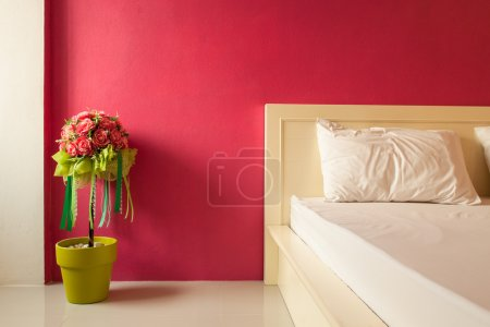 Decoration artificial flower in red bedroom