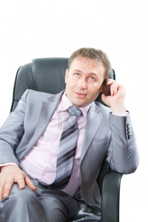Attractive successful business man talk mobile phone and at isolated white
