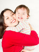 Happy mom and baby girl hugging and laughing.The concept of childhood and f