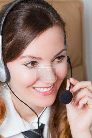 Headset. Customer service operator woman stewardess with headset smiling i