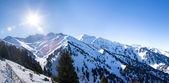 Panorama of Winter Snowy Mountains valley with sun in Ak Bulak, Almaty, Kazakhstan, Asia