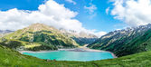 Panorama of spectacular scenic Big Almaty Lake ,Tien Shan Mountains in Almaty, Kazakhstan,Asia at summer
