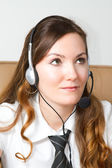 Portrait of happy smiling cheerful support phone operator in headset at office. CUSTOMER SERVICE AGENT