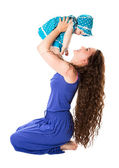Happy mom and child girl hugging isolate on white background. The concept of childhood and family. Beautiful Mother and her baby