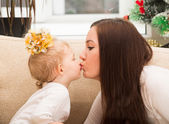 Mom and child kiss