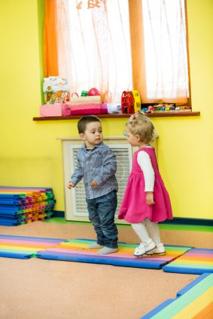Photo for Two kids in Montessori preschool Class. Little girl and boy playing in kindergarten - Royalty Free Image