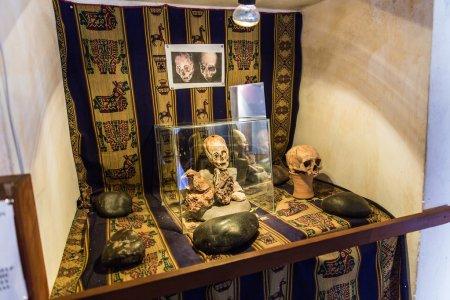 Embalmed mummy and skull in Peru.
