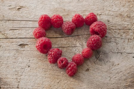 Photo for Some raspberries in a heart shape - Royalty Free Image