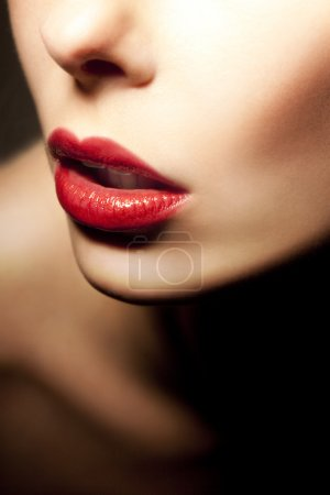 The girl's face with red lips close-up