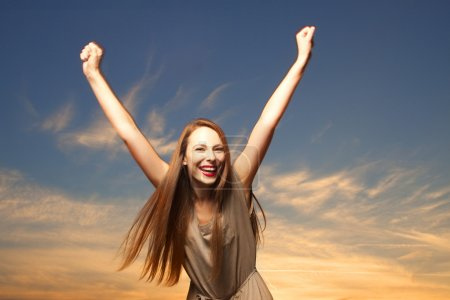 Photo for Beautiful, happy young woman in sunlight - Royalty Free Image