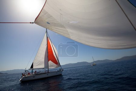 "SARONIC GULF, GREECE - SEPTEMBER 23: Sailors participate in sailing regatta ""Viva Greece 2012"" on September 23, 2012 on Saronic Gulf, Greece."