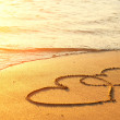 Hearts drawn on the sand of a beach...