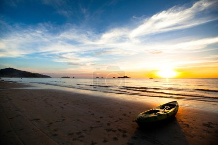 Kayak on the beach at sunset. Thailand.