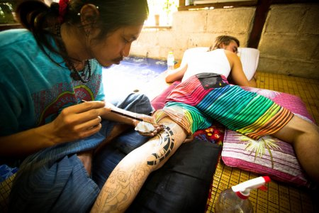 CHANG, THAILAND - DEC 24: Unidentified master makes traditional tattoo bamboo, Dec 24, 2012 in Chang, Thailand. Thai tattooists are very popular among tourists, prices range from 500 thai baht and up