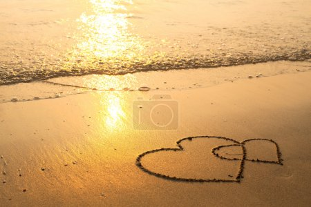 Hearts drawn on the sand
